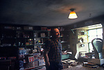 Shetland shop keeper. Shetland Islands, Highlands and islands, Scotland, UK.