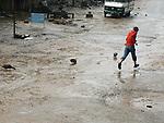 A boy runs through puddles to escape heavy rain in Bungmati. The ducks seemed to enjoy it...