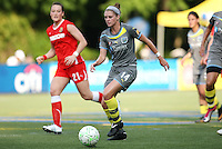 Philadelphia midfielder, Sinead Farrelly (14) cuts inside of WNY Flash midfielder, Brittany Bock (21).  The Philadephia Independence dropped a 2-1 decision to the Western New York Flash on Memorial Day weekend at Widener University in Chester, PA.