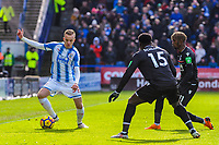 Huddersfield Town's defender Florent Hadergjonaj (33) on the ball with Crystal Palace's midfielder Jeffrey Schlupp (15) and Crystal Palace's midfielder Wilfried Zaha (11) close by during the EPL - Premier League match between Huddersfield Town and Crystal Palace at the John Smith's Stadium, Huddersfield, England on 17 March 2018. Photo by Stephen Buckley / PRiME Media Images.