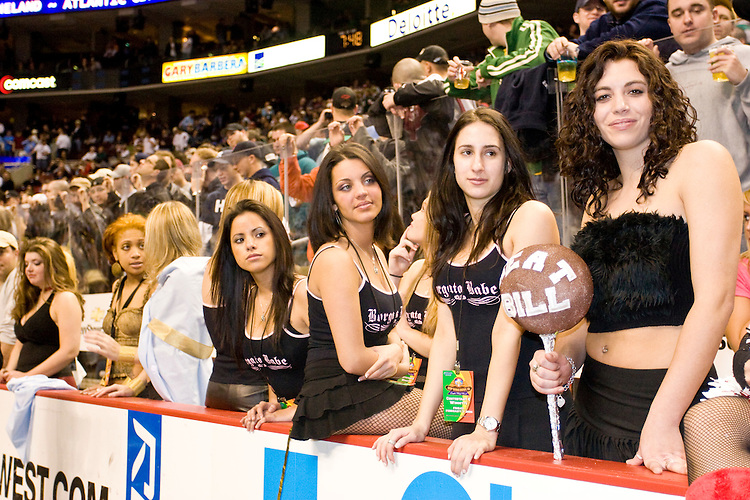 """Wingettes for """"Meat Bill"""" on the sidelines at the 14th annual Wing Bowl, held in Philadelphia on February 3, 2006 at the Wachovia Center.<br /> <br /> The Wing Bowl is a competitive eating event in which eaters try and down the most hot wings in 30 total minutes in front of a crowd of 10,000 plus people.  The real show however is all around the eaters, from the various scantily clad women (known as """"Wingettes"""") that make up eaters' entourages, to the behavior of the fans themselves."""