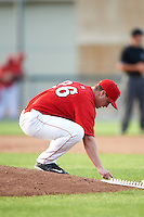 Auburn Doubledays relief pitcher Nick Conner (26) writes in the mound dirt during a game against the Mahoning Valley Scrappers on June 19, 2016 at Falcon Park in Auburn, New York.  Mahoning Valley defeated Auburn 14-3.  (Mike Janes/Four Seam Images)