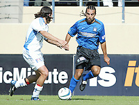 24 October 2004: Dwayne De Rosario of Earthquakes dribbles the ball away from Nick Garcia of Wizards at Spartan Stadium in San Jose, California.   Earthquakes defeated Wizards, 2-0.  Credit: Michael Pimentel / ISI