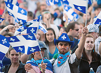 The Crowd wave Quebec flags during the St-Jean-Baptist show on the Plains of Abraham in Quebec city June 23, 2009.<br /> <br /> PHOTO :  Francis Vachon - Agence Quebec Presse