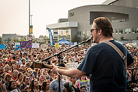 Zachary Carothers of Grammy-winning Alaskan rock band Portugal. The Man as they perform at a rally to override the governor's vetoes at the Alaska Airlines Center.