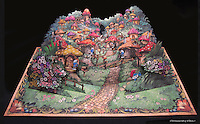 The finished pop-up book open to the Smurf Village scene.