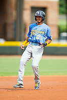Luis Sardinas (23) of the Myrtle Beach Pelicans puts on the brakes as he rounds second base after hitting a double against the Winston-Salem Dash at BB&T Ballpark on July 7, 2013 in Winston-Salem, North Carolina.  The Pelicans defeated the Dash 6-5 in 8 innings in game two of a double-header.  (Brian Westerholt/Four Seam Images)