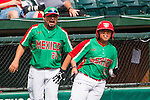 ABERDEEN, MD - AUGUST 01: Victor Sanchez #13 of Mexico runs to second base after an error by Canada on his three run RBI single against Canada as coach Joel Hadar #24 reacts in a game between Mexico and Canada during the Cal Ripken World Series at The Ripken Experience Powered by Under Armour on August 1, 2016 in Aberdeen, Maryland. (Photo by Ripken Baseball/Eclipse Sportswire/Getty Images)