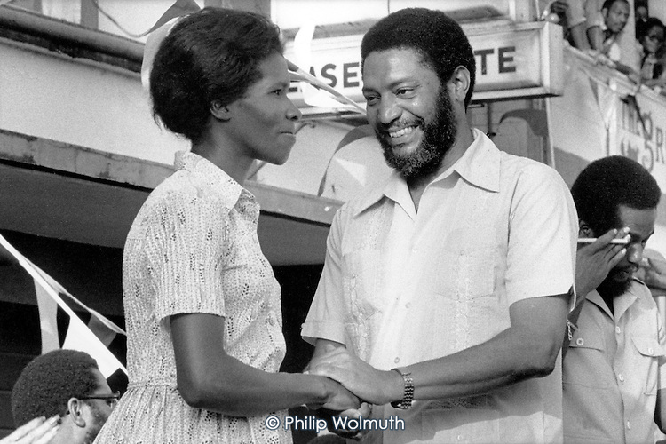 Prime Minister Maurice Bishop congratulates an award winner during a 'Workers' Emulation' ceremony in St.Georges.