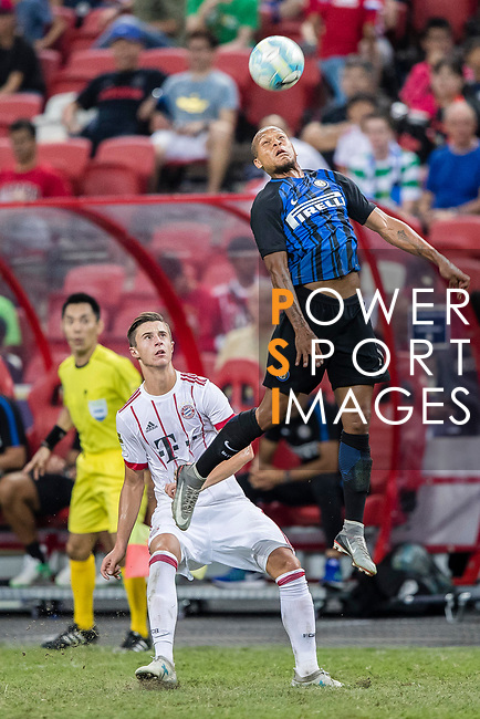 FC Internazionale Forward Jonathan Biabiany (R) heads the ball during the International Champions Cup match between FC Bayern and FC Internazionale at National Stadium on July 27, 2017 in Singapore. Photo by Marcio Rodrigo Machado / Power Sport Images