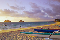 Sunrise over the scenic Moku Lua islands and Lanikai Beach with outrigger canoes in the forground. Windward Oahu.