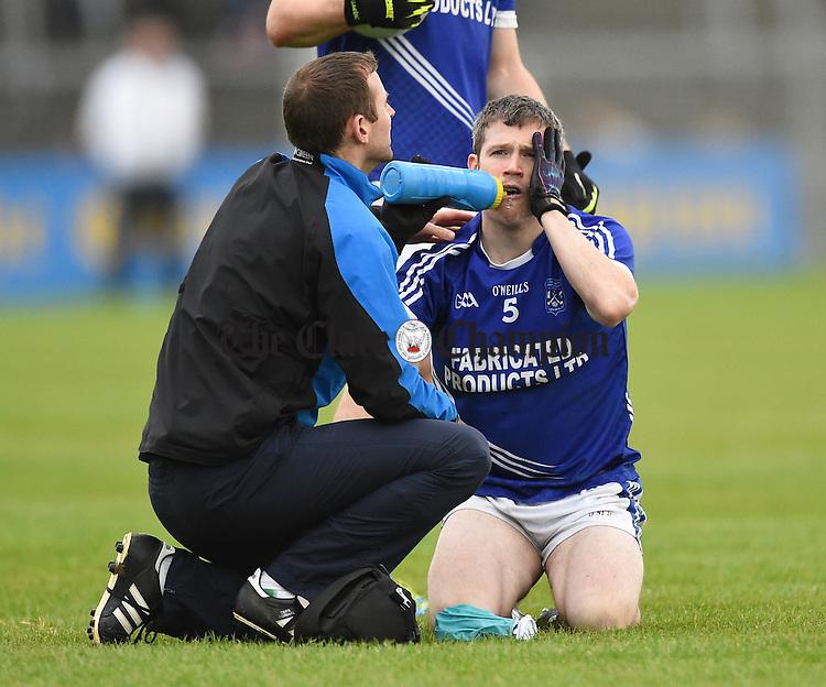 Martin Oige Murphy nurses an injury  during their senior football final replay at Cusack park. Photograph by John Kelly.