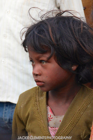 This young girl was captivated by a group of roving musicians at the Maha Kumbh Mela.