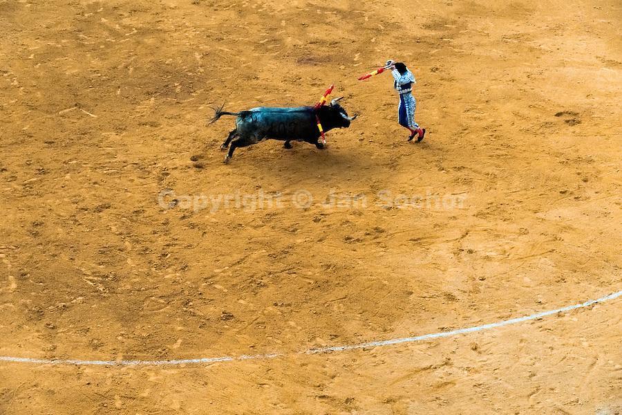 A Spanish bullfighter (banderillero) performs at the bullring in Granada, Spain, 7 June 2006.