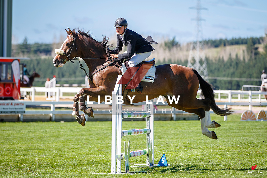 NZL-Lucas Bremner rides Triple Star Destinys Accolade. Class 25: Horse 1.10m Ranking Class. 2021 NZL-Easter Jumping Festival presented by McIntosh Global Equestrian and Equestrian Entries. NEC Taupo. Saturday 3 April. Copyright Photo: Libby Law Photography