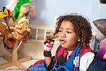 Education preschool 3-4 year olds pretend play boy pretending toy ice cream cone is a telephone talking pretending horizontal