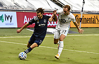 KANSAS CITY, KS - SEPTEMBER 13: Graham Zusi #8 of Sporting Kansas City tries to clear the ball upfield as Chase Gasper #77 of Minnesota United FC tries to stop him during a game between Minnesota United FC and Sporting Kansas City at Children's Mercy Park on September 13, 2020 in Kansas City, Kansas.
