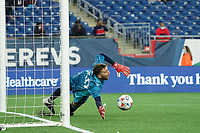 FOXBOROUGH, MA - MAY 1: Matt Turner #30 of New England Revolution dives for a penalty kick during a game between Atlanta United FC and New England Revolution at Gillette Stadium on May 1, 2021 in Foxborough, Massachusetts.