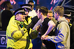 """© Joel Goodman - 07973 332324 . 17/12/2016 . Manchester , UK . Police intervene to prevent a fight from escalating , outside The Birdcage on Withy Grove . Revellers out in Manchester City Centre overnight during """" Mad Friday """" , named for being one of the busiest nights of the year for the emergency services in the UK . Photo credit : Joel Goodman"""