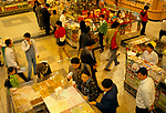 Beijing China 1990s. Wealthy new money rich middle professional class shopping at a self service sweet counter in a department store 1998