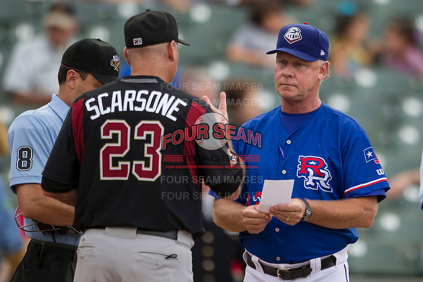 Round Rock Express manager Steve Buechele (22) meets with Sacrament River Cats manager Steve Scarsone (23) before the Pacific Coast League baseball game on June 19, 2014 at the Dell Diamond in Round Rock, Texas. The Express defeated the River Cats 7-1. (Andrew Woolley/Four Seam Images)