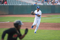 Ogden Raptors third baseman Jefrey Souffront (29) prepares to make a throw to first base as Maiker Feliz (7) runs up the line during a Pioneer League game against the Great Falls Voyagers at Lindquist Field on August 23, 2018 in Ogden, Utah. The Ogden Raptors defeated the Great Falls Voyagers by a score of 8-7. (Zachary Lucy/Four Seam Images)