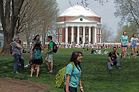 ALTERED STATE PHOTO ESSAY/ANDREW SHURTLEFF<br /> UVa students take advantage of warm temperatures at the University of Virginia.<br /> <br /> Shut downs and stay-in-place orders, the most recent of which came from Gov. Ralph Northam Monday, have left Charlottesville dormant. Students have been sent home, many businesses have shut their doors and events have been canceled. In this photo essay, photographer Andrew Shurtleff has spent time capturing the effects of the pandemic and comparing the duality of the present with our social past.