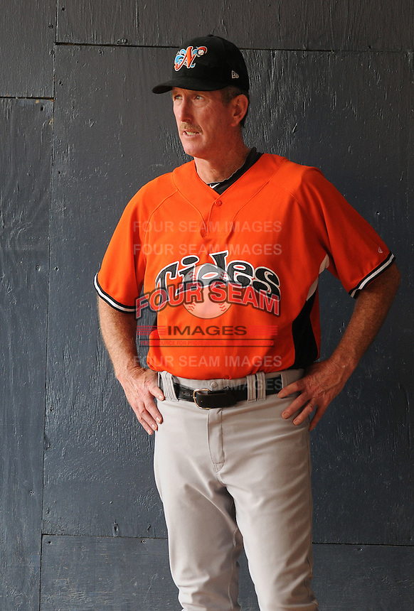 Pitching coach Mike Griffin (27) of the Norfolk Tides, International League affiliate of the Baltimore Orioles, prior to a game against the Scranton/Wilkes-Barre Yankees on June 20, 2011, at PNC Park in Moosic, Pennsylvania. (Tom Priddy/Four Seam Images).