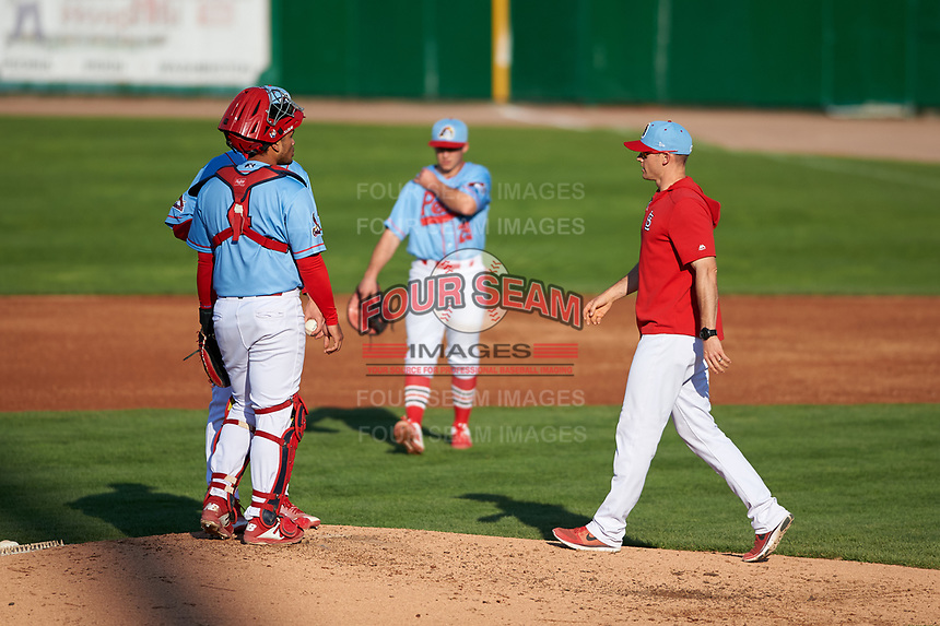 Peoria Chiefs pitching coach Cale Johnson (27) approaches the mound during a Midwest League game against the Bowling Green Hot Rods at Dozer Park on May 5, 2019 in Peoria, Illinois. Peoria defeated Bowling Green 11-3. (Zachary Lucy/Four Seam Images)