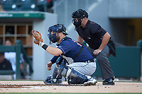 Toledo Mud Hens catcher Cameron Rupp (26) sets a target as home plate umpire Jeremy Riggs looks on during the game against the Charlotte Knights at BB&T BallPark on April 24, 2019 in Charlotte, North Carolina. The Knights defeated the Mud Hens 9-6. (Brian Westerholt/Four Seam Images)