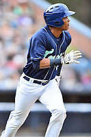 Asheville Tourists center fielder Daniel Montano (24) runs to first base during a game against the West Virginia Power at McCormick Field on April 18, 2019 in Asheville, North Carolina. The Power defeated the Tourists 12-7. (Tony Farlow/Four Seam Images)