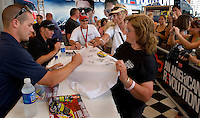 Fans (no model releases) get autographs at the 2007 Speed Street festival. For several days leading up to the May races at the Lowe's Motor Speedway, uptown Charlotte streets are transformed into a showcase of motor sports and non-stop entertainment. ..Photo taken in 2007. Photographer also has images from 2008.