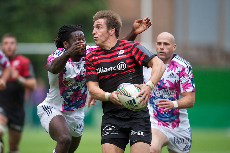 20120823 Copyright onEdition 2012©.Free for editorial use image, please credit: onEdition..Chris Wyles of Saracens is tackled by Paul Sackey of Stade Francais Paris at The Honourable Artillery Company, London in the pre-season friendly between Saracens and Stade Francais Paris...For press contacts contact: Sam Feasey at brandRapport on M: +44 (0)7717 757114 E: SFeasey@brand-rapport.com..If you require a higher resolution image or you have any other onEdition photographic enquiries, please contact onEdition on 0845 900 2 900 or email info@onEdition.com.This image is copyright the onEdition 2012©..This image has been supplied by onEdition and must be credited onEdition. The author is asserting his full Moral rights in relation to the publication of this image. Rights for onward transmission of any image or file is not granted or implied. Changing or deleting Copyright information is illegal as specified in the Copyright, Design and Patents Act 1988. If you are in any way unsure of your right to publish this image please contact onEdition on 0845 900 2 900 or email info@onEdition.com