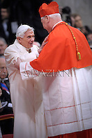 German cardinal Gerhard Ludwig Muller  is congratulated by Pope emeritus Benedict XVI  after he was appointed cardinal by the Pope at the consistory in the St. Peter's Basilica at the Vatican on February 22, 2014.