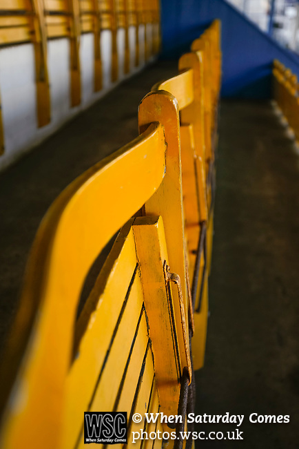 Yellow seats in the Jamie Vardy Stand at Look Local Stadium. The seats were originally used at Hillsborough. Stocksbridge Park Steels v Pickering Town, Evo-Stik East Division, 17th November 2018. Stocksbridge Park Steels were born from the works team of the local British Steel plant that dominates the town north of Sheffield.<br /> Having missed out on promotion via the play offs in the previous season, Stocksbridge were hovering above the relegation zone in Northern Premier League Division One East, as they lost 0-2 to Pickering Town. Stocksbridge finished the season in 13th place.