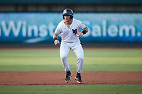 AJ Gill (7) of the Winston-Salem Dash takes his lead off of second base against the Hickory Crawdads at Truist Stadium on July 10, 2021 in Winston-Salem, North Carolina. (Brian Westerholt/Four Seam Images)
