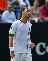 Netherlands, Den Bosch, 15.06.2014. Tennis, Topshelf Open, Aleksandr Nedovyesov (KAZ) is frustrated<br /> Photo:Tennisimages/Henk Koster