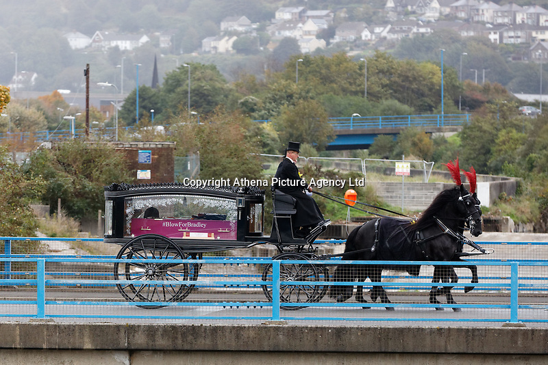 """Pictured: The horse drawn carriage drives towards Margam Crematorium, Wales, UK. Monday 08 October 218<br /> Re: A grieving father will mourners on horseback at the funeral of his """"wonderful"""" son who killed himself after being bullied at school.<br /> Talented young horse rider Bradley John, 14, was found hanged in the school toilets by his younger sister Danielle.<br /> Their father, farmer Byron John, 53, asked the local riding community to wear their smart hunting gear at Bradley's funeral.<br /> Police are investigating Bradley's death at the 500-pupils St John Lloyd Roman Catholic school in Llanelli, South Wales.<br /> Bradley's family claim he had been bullied for two years after being diagnosed with Attention Deficit Hyperactivity Disorder.<br /> He went missing during lessons and was found in the toilet cubicle by his sister Danielle, 12."""