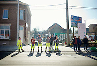roadworkers waiting for the peloton to fly by<br /> <br /> GP Le Samyn 2014