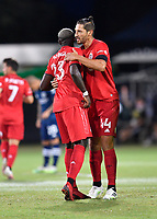 LAKE BUENA VISTA, FL - JULY 26: Omar González of Toronto FC and teammate Chris Mavinga embrace during a game between New York City FC and Toronto FC at ESPN Wide World of Sports on July 26, 2020 in Lake Buena Vista, Florida.