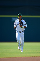 Augusta GreenJackets Jose Layer (22) jogs to the dugout during a South Atlantic League game against the Lexington Legends on April 30, 2019 at SRP Park in Augusta, Georgia.  Augusta defeated Lexington 5-1.  (Mike Janes/Four Seam Images)