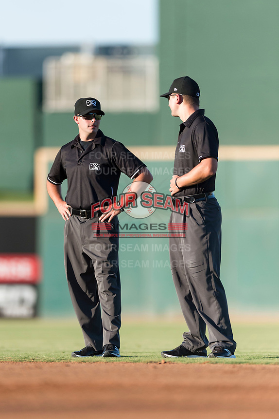 Field umpires Paul Roemer and Kevin Levine during an Arizona League playoff game between the AZL Rangers and the AZL Indians 1 at Goodyear Ballpark on August 28, 2018 in Goodyear, Arizona. The AZL Rangers defeated the AZL Indians 1 7-4. (Zachary Lucy/Four Seam Images)