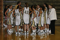 Bill Westphal, Head Coach of the Point Loma Nazarene University Sea Lions Womens Basketball team speaks with his players after their 71 - 51 victory over UW Eau Claire during the 2007 Surf N Slam Women?s Basketball Tournament at Golden Gymnasium on the PLNU campus in San Diego, Saturday December 29 2007.   PLNU played host to the tournament December 27, 28 and 29.  The eight team field included seven NCAA DIII schools; UW Stevens Point, UW Eau Claire, Carroll (WI), Gustavus Adolphus (MN), Ithaca (NY), Maryville (MO), Rivier (NH). Point Loma was the only NAIA school competing and defeated Wisconsin-Eau Claire 71-51 Saturday in Golden Gymnasium to take fourth place.  The tournament was won by Maryville who defeated Gustavus Aldolphus 68-64 in the final game on Saturday.