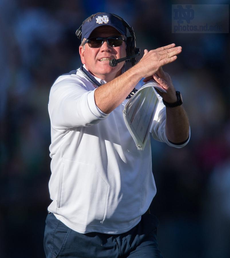 Oct 11, 2014; Head coach Brian Kelly calls a timeout in the North Carolina game. (Photo by Matt Cashore)