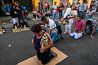 Mexican worshippers of Santa Muerte (Holy Death) crawl on their knees during a religious pilgrimage in Tepito, a violent neighborhood of Mexico City, Mexico, 1 April 2018. The religious cult of Santa Muerte is a fusion of Aztec death worship rituals and Catholic beliefs. Born in lower-class neighborhoods of Mexico City, it has always been closely associated with crime. In the past decades, original Santa Muerte followers, such as prostitutes, pickpockets and street drug traffickers, have merged with thousands of ordinary Mexican Catholics. The Holy Death veneration, offering a spiritual way out of hardship in modern society, rapidly expanded. Although the Catholic Church still considers Santa Muerte followers the devil worshippers, on the first day of every month, crowds of Santa Muerte believers fill the streets of Tepito. Holding statues of Holy Death clothed in a long robe, they pray for healing, protection, money or any other favor in life.