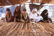 Children born into slavery work all day lond in making matts in the are of Boutlimit, Mauritania - Child labor as seen around the world between 1979 and 1980 - Photographer Jean Pierre Laffont, touched by the suffering of child workers, chronicled their plight in 12 countries over the course of one year.  Laffont was awarded The World Press Award and Madeline Ross Award among many others for his work.