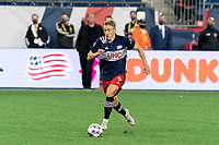 FOXBOROUGH, MA - APRIL 24: Adam Buksa #9 of New England Revolution on the attack during a game between D.C. United and New England Revolution at Gillette Stadium on April 24, 2021 in Foxborough, Massachusetts.