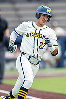Michigan Wolverines outfielder Tito Flores (22) runs to first base against the Maryland Terrapins on May 23, 2021 in NCAA baseball action at Ray Fisher Stadium in Ann Arbor, Michigan. Maryland beat the Wolverines 7-3. (Andrew Woolley/Four Seam Images)