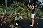 Beach nearby Delices village. Coconuts harvesting<br /> Recolte de noix de cocos sur la cote sud est de l'ile vers le village de Delices.