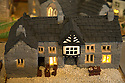 """08/12/16<br /> <br /> Bulls Head Hotel.<br /> <br /> In this incredibly detailed replica of a small Peak District village, everything is edible, from the baubles on the Christmas trees to the flowers around the houses and what's more the """"village"""" is made from 35 individual rich fruit Christmas cakes which will be eaten on the 25th!<br /> <br /> The amazing model village is made up of 18 shops and houses, which are all realistic reproductions of the actual buildings found in Youlgreave, and is open to the public to view at All Saints' church, the main focal point of the miniature masterpiece.<br /> <br /> Retired florist Lynn Nolan, who decorated all the cakes, came up with the original idea as a way of raising money for the church, which needs a new roof, and the first of the cakes went in the oven back in April.<br /> <br /> MORE...https://fstoppressblog.wordpress.com/the-village-thats-really-a-christmas-cake/<br /> <br /> All Rights Reserved F Stop Press Ltd. (0)1773 550665   www.fstoppress.com"""